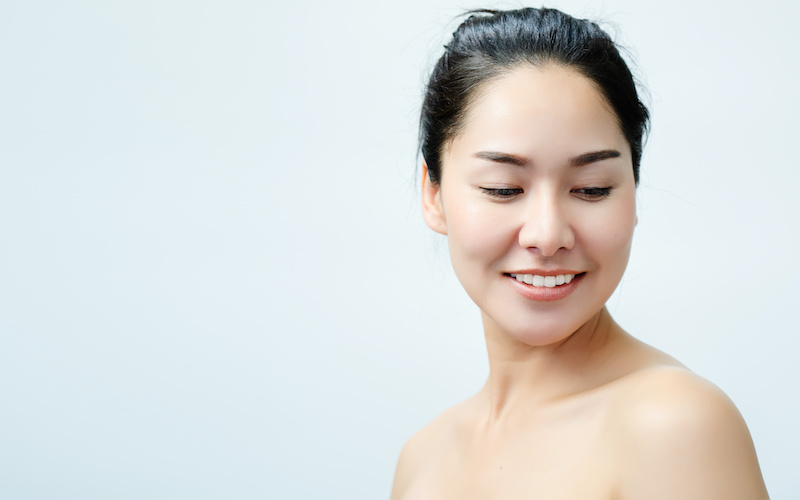 Portrait nude young Asian woman Close up of beautiful faces Feel Happy. Smile with a healthy white teeth.